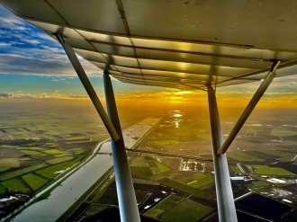 Washes, by Adrian Gardener. Chatteris instructor Adrian in a C42 over the Ouse Washes in Cambridgeshire.