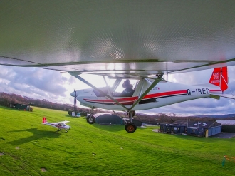 Deanlands, by Mikey McMahon. MIkey and instructor Luke Christophides landing at Deanland in Sussex.
