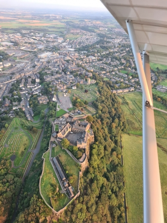 """Stirling Castle, by Rory Slater. """"The castle looking stunning on a summer evening's flight from Balado,"""" said Rory."""