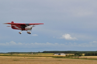Ian Forrest, by Colin Rodger. Ian landing at Kingsmuir strip in Fife, taken by BMAA inspector Colin.