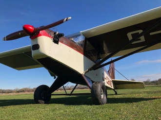 "Hi-Max by Clive Mason. ""The Hi-Max basking in the sunshine getting ready for the new flying season. With the split door system I think she's going to make the perfect little camera ship,"" said Clive."